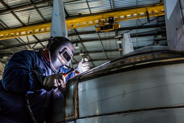 Welder repairing vessels